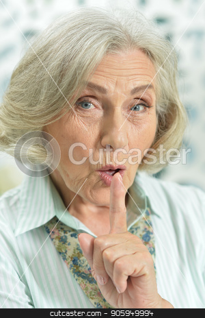 Portrait of a cute woman stock photo, Portrait of a beautiful senior woman gesturing silence by Ruslan Huzau