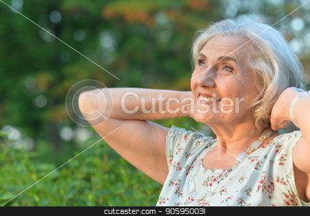 beautiful senior woman stock photo, Portrait of beautiful senior woman  in summer park by Ruslan Huzau