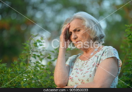beautiful sad senior woman stock photo, Portrait of beautiful sad senior woman  in summer park by Ruslan Huzau