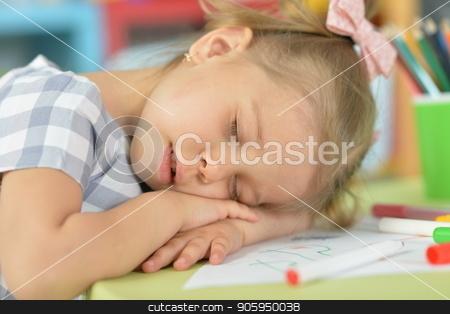 cute little girl sleeping stock photo, cute little girl sleeping while sitting at table in her room by Ruslan Huzau