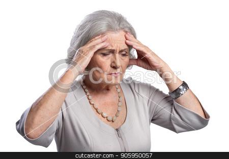 senior woman with headache stock photo, beautiful Sad senior woman with headache isolated on white background by Ruslan Huzau