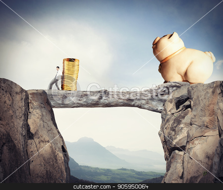 Businessman moves a pile of coins to a moneybox. concept of difficulty to saving money stock photo, Businessman moves a pile of golden coins to a moneybox. concept of difficulty to saving money by Federico Caputo
