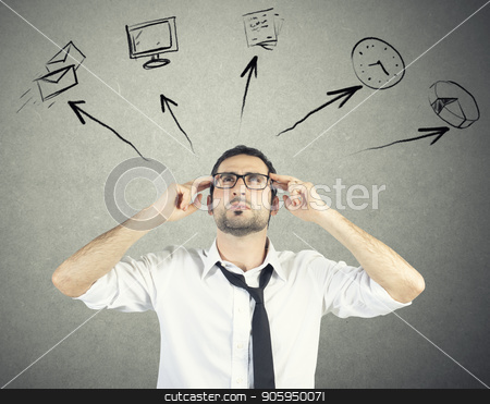 Stressed businessman tries to plan his work day stock photo, Stressed businessman tries to plan his work day tasks by Federico Caputo