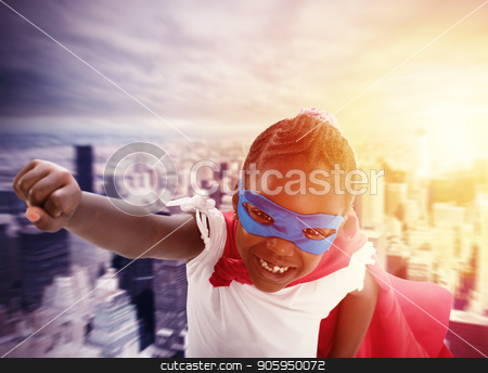 Child acts like a superhero to save the world stock photo, Child acts like a brave superhero to save the world by Federico Caputo