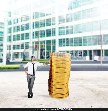 Successful businessman with a pile of money stock photo, Successful businessman with a pile of golden money by Federico Caputo
