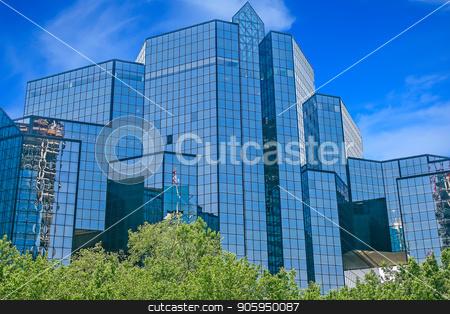 Blue Glass Financial Center stock photo, A massive blue glass financial center against the sky by Darryl Brooks