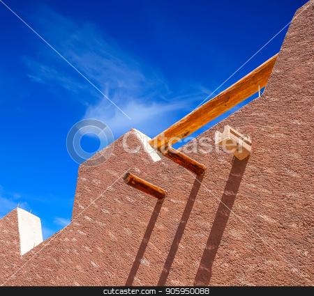 Brown Stucco Blue Sky stock photo, A nice textured stucco wall against a blue sky by Darryl Brooks