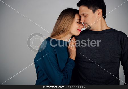 portrait: man and woman kissing on white background. Husband and wife face to face stock photo, portrait: man and woman kissing on white background. Husband and wife face to face by aaalll3110