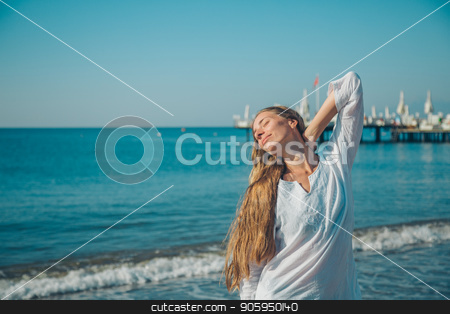 Portrait of a woman on a background of sea stock photo, Portrait of a woman on a background of sea by aaalll3110