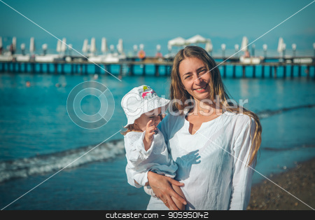 Portrait of a woman with child on a background of sea stock photo, Portrait of a woman with child on a background of sea by aaalll3110