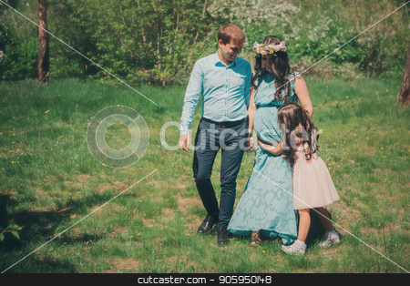 man, pregnant woman and little girl: family photo outdoors stock photo, man, pregnant woman and little girl: family photo outdoors by aaalll3110