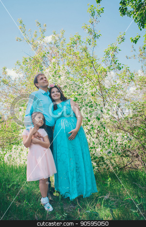 man, pregnant woman and little girl: family photo outdoors. fashion for the whole family stock photo, man, pregnant woman and little girl: family photo outdoors. fashion for the whole family by aaalll3110