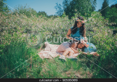 portrait of a pregnant woman and little girl: mother and daughet lying on the ground on a grass background stock photo, portrait of a pregnant woman and little girl: mother and daughet lying on the ground on a grass background by aaalll3110