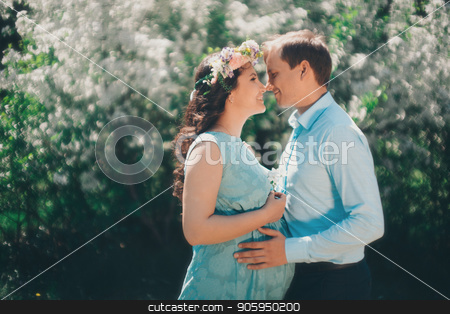 Man hugs his pregnant woman from behind standing in the forest stock photo, Man hugs his pregnant woman from behind standing in the forest by aaalll3110