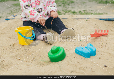 little girl playing with colorful molds in the sandbox stock photo, little girl playing with colorful molds in the sandbox by aaalll3110