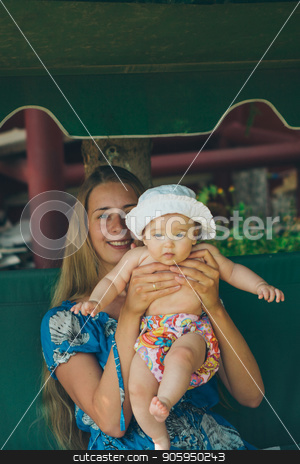 Portrait of a girl with a child on a green background stock photo, Portrait of a girl with a child on a green background by aaalll3110