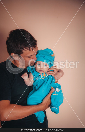 baby on the hands of father. man and child in a black and blue stock photo, baby on the hands of father. man and child in a black and blue by aaalll3110