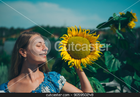 Portrait of a girl with flower on a background of green foliage stock photo, Portrait of a girl with flower on a background of green foliage by aaalll3110