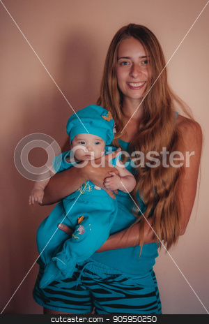 baby on the hands of mother. woman and child in blue stock photo, baby on the hands of mother. woman and child in blue by aaalll3110