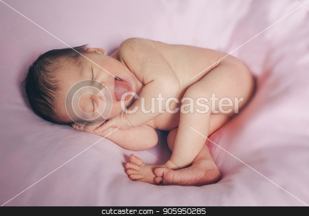 Portrait of newborn baby on a pink background. stock photo, Portrait of newborn baby on a pink background. by aaalll3110