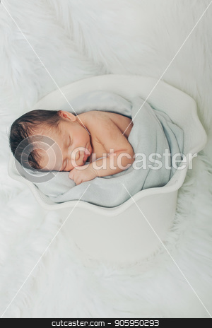 A little child lies in the white basket stock photo, A little child lies in the white basket by aaalll3110
