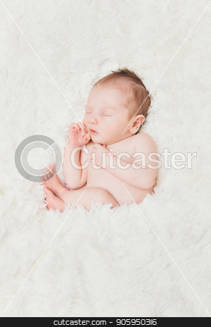 newborn baby lying on a white background. Imitation of a baby in the womb. beautiful little girl sleeping lying on her back. stock photo, newborn baby lying on a white background. Imitation of a baby in the womb. beautiful little girl sleeping lying on her back. by aaalll3110