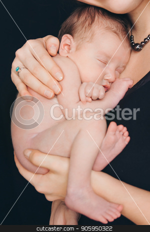 newborn baby lying on the hands of parents on a black background. stock photo, newborn baby lying on the hands of parents on a black background. by aaalll3110
