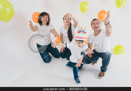 a group of five people on the background of balloons. Family photo at the party stock photo, a group of five people on the background of balloons. Family photo at the party by aaalll3110