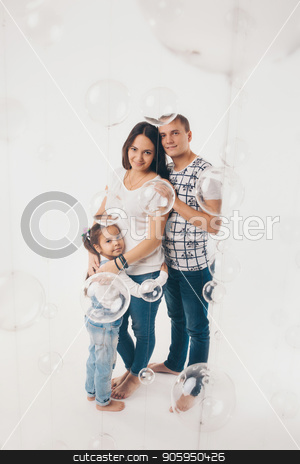Portrait of a girl who holds her parents ' hands on a white background stock photo, Portrait of a girl who holds her parents ' hands on a white background by aaalll3110