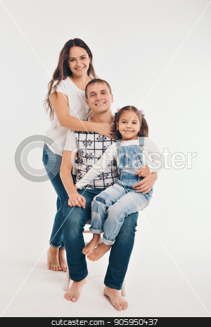 Portrait of a girl who holds her parents ' hands on a white background. Fashion for family stock photo, Portrait of a girl who holds her parents ' hands on a white background. Fashion for family by aaalll3110