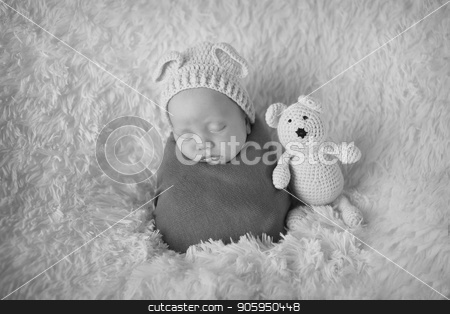 newborn baby lying on a white and black background. Imitation of a baby in the womb. beautiful little child sleeping lying on her tummy. Portrait of newborn stock photo, newborn baby lying on a white and black background. Imitation of a baby in the womb. beautiful little child sleeping lying on her tummy. Portrait of newborn by aaalll3110