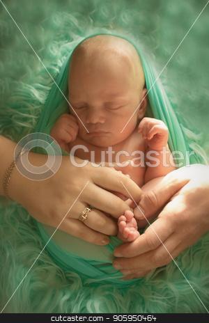 A little child in a greeen diaper lies on a green background stock photo, A little child in a green diaper lies on a green background by aaalll3110