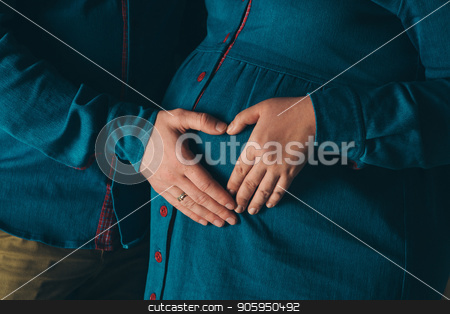 pregnant woman and man holding hands heart shaped on belly on a white background stock photo, pregnant woman and man holding hands heart shaped on belly on a white background by aaalll3110