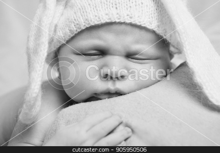 portrait of newborn baby in a hat with ears. Newborn fashion stock photo, portrait of newborn baby in a hat with ears. Newborn fashion by aaalll3110
