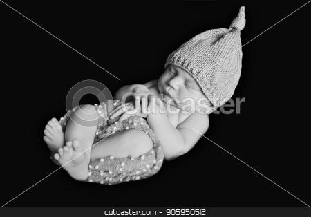 portrait of newborn baby in a hat on a black background. Newborn fashion stock photo, portrait of newborn baby in a hat on a black background. Newborn fashion by aaalll3110