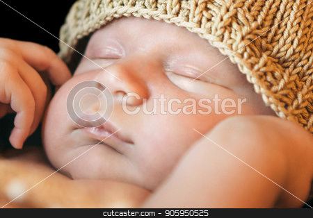 portrait of newborn baby in a yellow or gold hat on a black background. Newborn fashion stock photo, portrait of newborn baby in a hat on a black background. Newborn fashion by aaalll3110