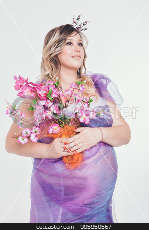 Pregnant woman in long dress with crown and flowers on white background stock photo, Pregnant woman in long dress with crown and flowers on white background by aaalll3110