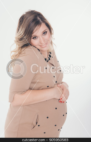 pregnant woman holding hands on belly on a white background stock photo, pregnant woman holding hands on belly on a white background by aaalll3110