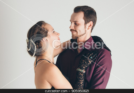 portrait: man in suit and woman in dress on white background. pair in an isolated photo. Husband hugs wife stock photo, portrait: man in suit and woman in dress on white background. pair in an isolated photo. Husband hugs wife by aaalll3110
