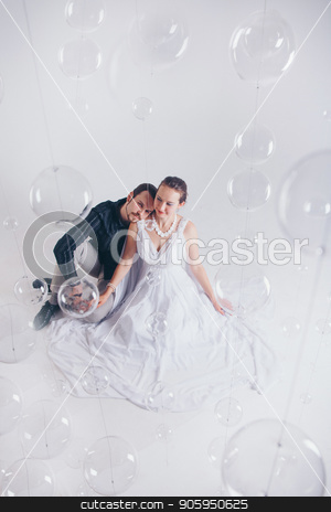 portrait of a man and a woman on a white background. Pair in suit and dress stock photo, portrait of a man and a woman on a white background. Pair in suit and dress by aaalll3110