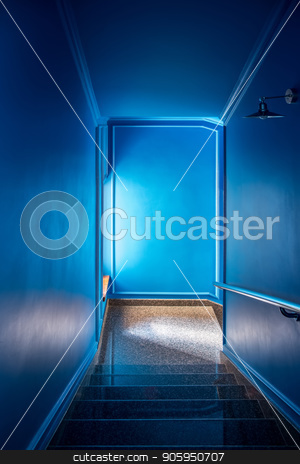 Stylish interior in hotel stock photo, Glossy tiled stair with a handrail in the hotel with blue walls. There is a window and a hanging metal lamp on the right wall. Vertical. by bezikus