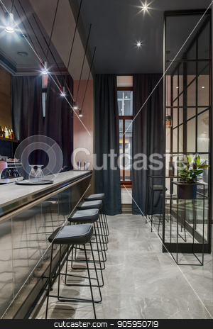 Stylish bar in hotel stock photo, Bar in the hotel with light walls and a gray tiled floor. There is a glossy bar rack with black chairs, small tables, shelf with drinks, coffee machine, green plant, window, luminous lamps. Vertical. by bezikus