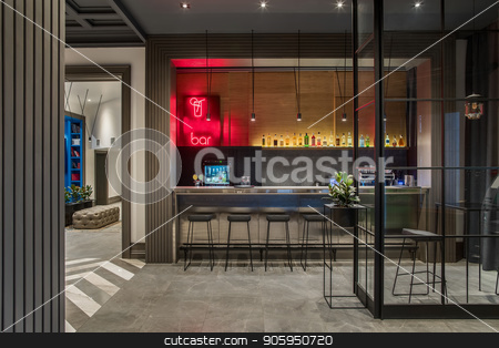 Luminous bar in hotel stock photo, Stylish bar in the hotel with light walls and a gray tiled floor. There is a glossy bar rack with black chairs, small tables, shelf with drinks, coffee machine, green plants, luminous lamps. by bezikus