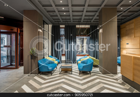Stylish interior in hotel stock photo, Beautiful hallway with luminous lamps in the hotel with dark ceiling and patterned tiled floor. There is a glass entrance door, multicolored armchairs and sofas, tables, wooden reception, columns. by bezikus