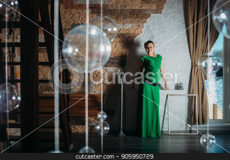 Portrait of pregnant woman in long dress on background stock photo, Portrait of pregnant woman in long dress on background by aaalll3110