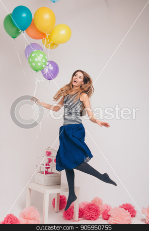 the girl flies holding the balloons. flying a balloon. magic party. practical magic stock photo, the girl flies holding the balloons. flying a balloon. magic party. practical magic by aaalll3110
