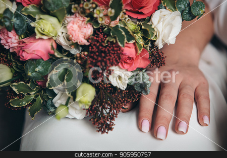 Hand of the bride with a bouquet of flowers stock photo, Hand of the bride with a bouquet of flowers by aaalll3110