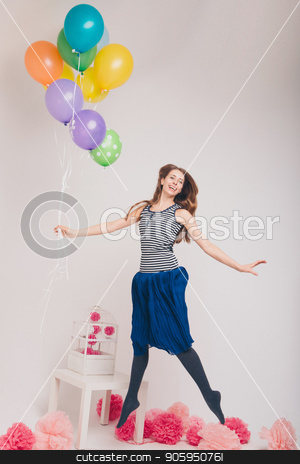 the girl is flying, holding balls. flying balloon. magic party. practical magic stock photo, the girl is flying, holding balls. flying balloon. magic party. practical magic by aaalll3110