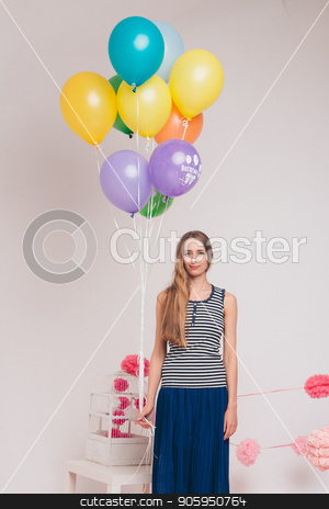 blonde with colored balls on white background. Studio portrait of an attractive girl waiting for her birthday. stock photo, blonde with colored balls on white background. Studio portrait of an attractive girl waiting for her birthday. by aaalll3110