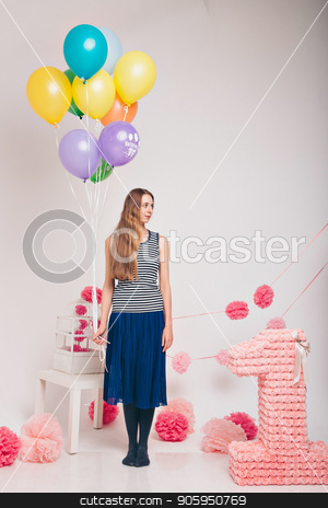the blonde woman with the colored balls on a white background. Studio portrait of an attractive girl waiting for her birthday. stock photo, the blonde woman with the colored balls on a white background. Studio portrait of an attractive girl waiting for her birthday. by aaalll3110